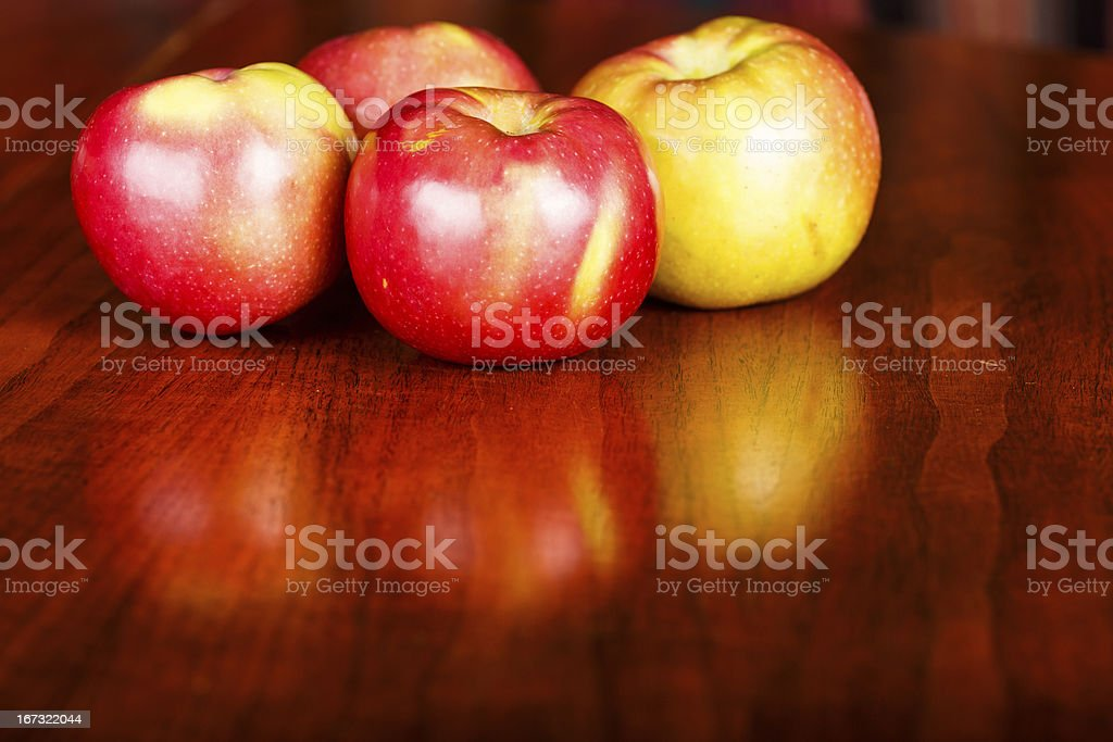 Red Apples on a Shiny Wood Table royalty-free stock photo