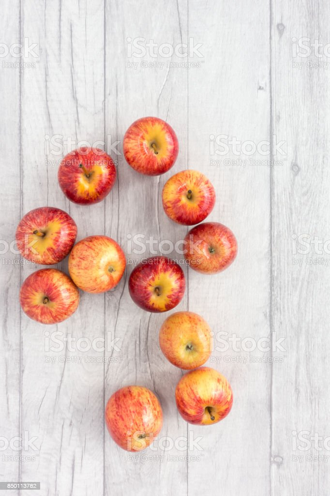 Red Apples on Grey Wood Background stock photo