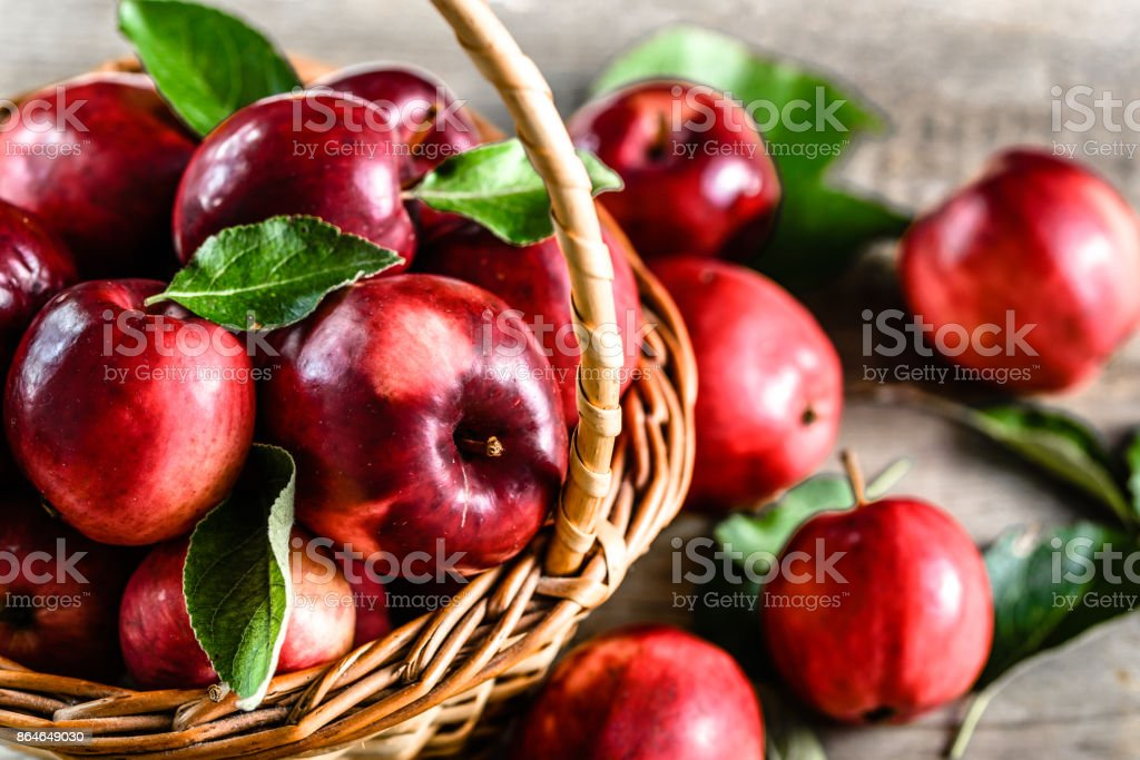Red apples on table, basket of red apple fruits, organic healthy food concept stock photo
