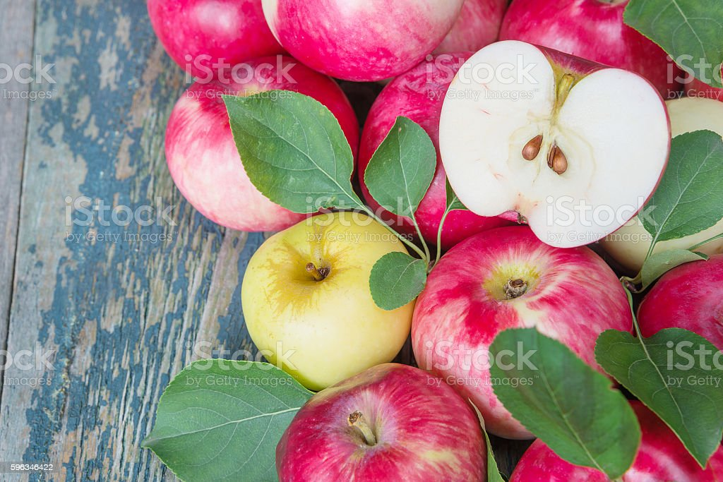 Red apples on the wooden background royalty-free stock photo