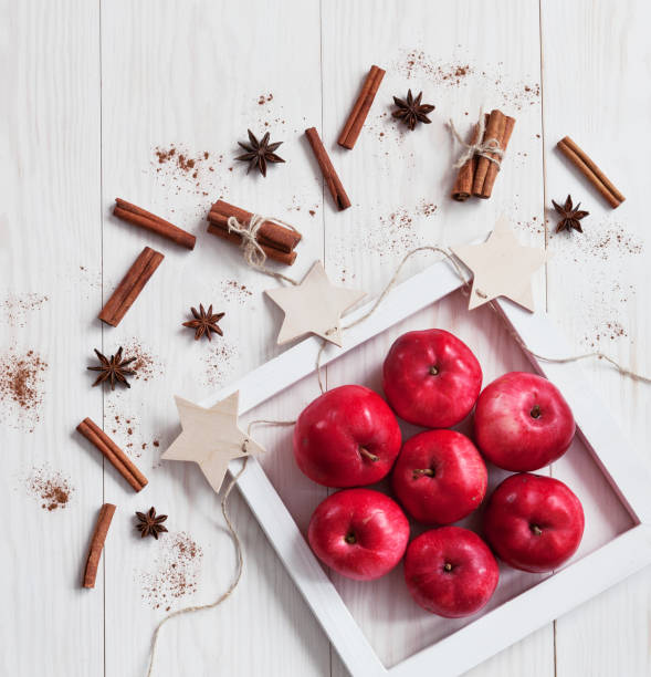 Red apples on white wooden background stock photo