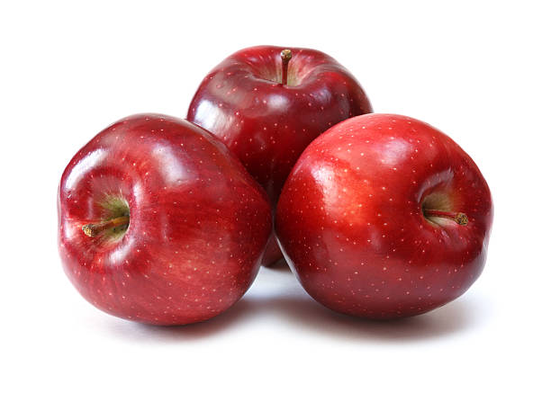red apples red delicious apples over white background red delicious apple stock pictures, royalty-free photos & images