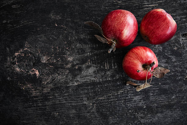 red apples - food styling stock photos and pictures
