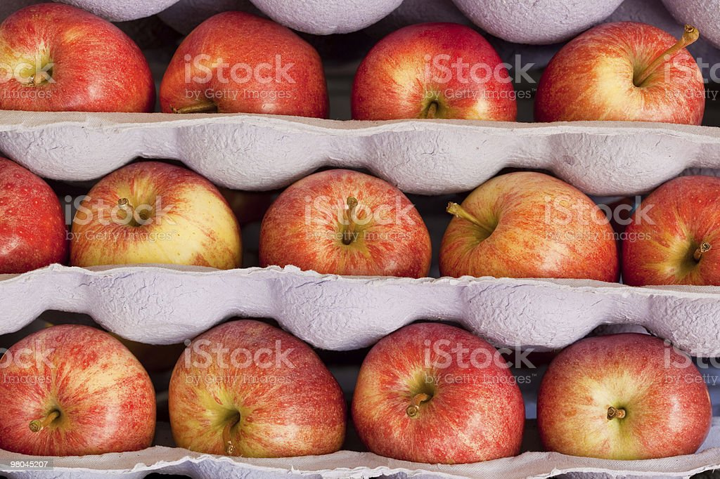 Red apples stacked in trays royalty-free stock photo
