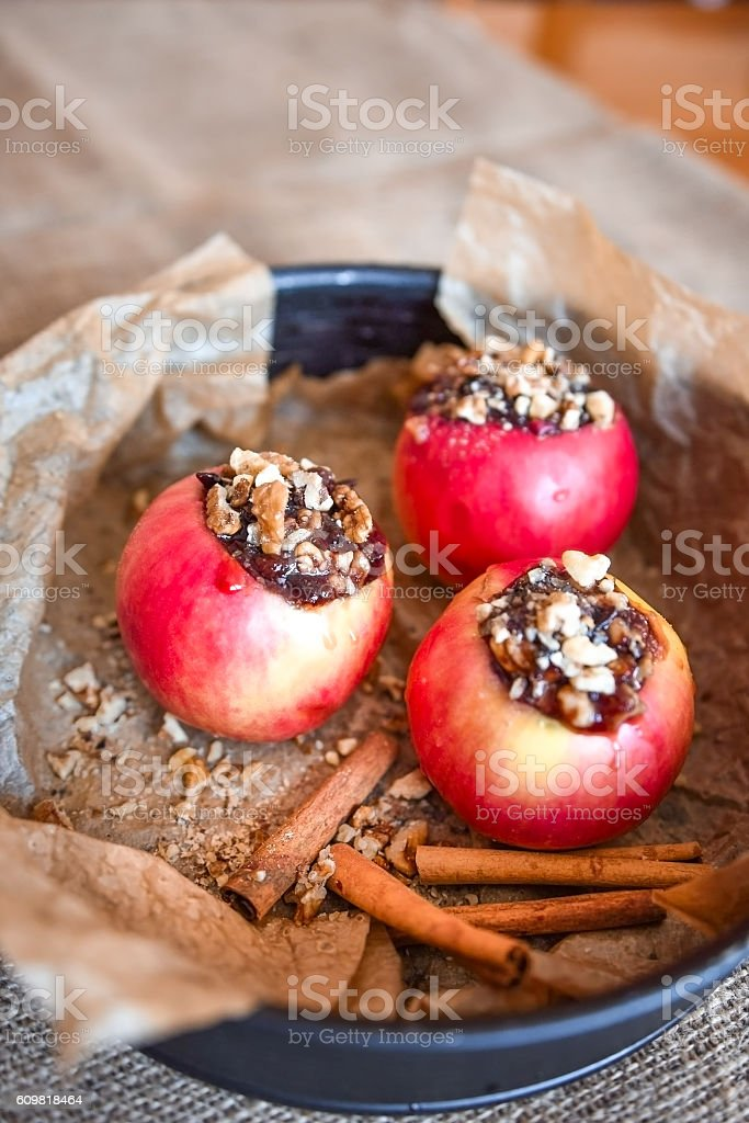 Red apples stuffed with jam and nuts ready for baking stock photo