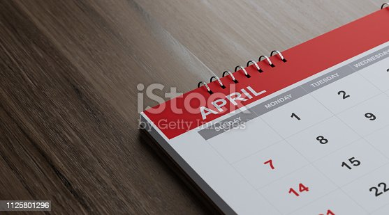 1124594277istockphoto Red April 2019 Calendar On  Brown Wood Surface 1125801296