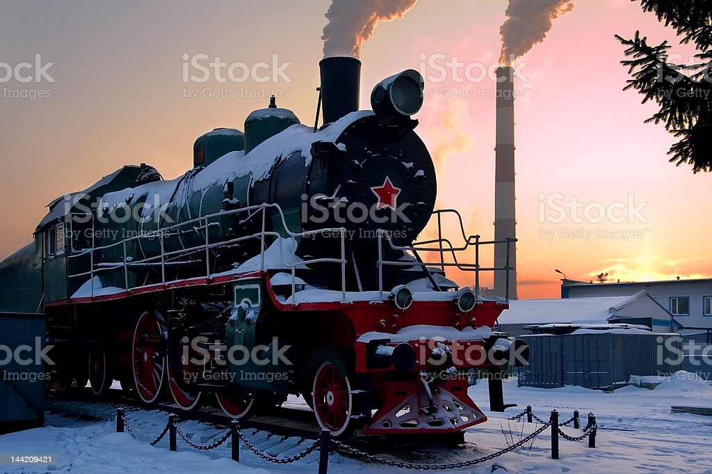 Red army old steam locomotive smokes in the morning royalty-free stock photo