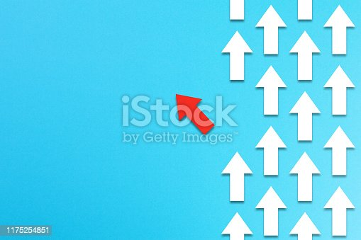 1088508096 istock photo Red arrow coming out from the advancing white arrows, different business concept 1175254851