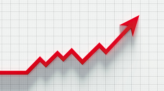 Red arrow symbol forming a line graph over a graph paper background. Horizontal composition with copy space.