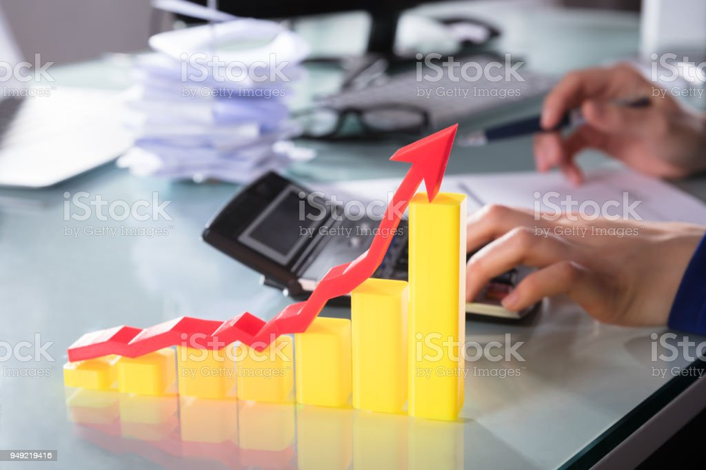 Red Arrow Over Increasing Graph stock photo