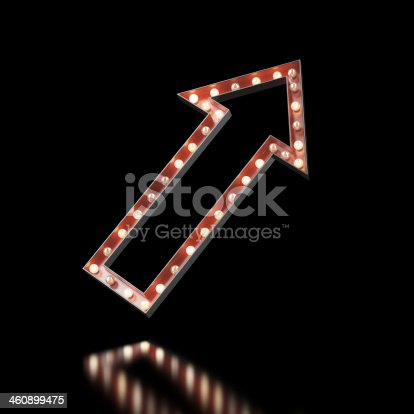 istock Red arrow sign lit up on a black background 460899475