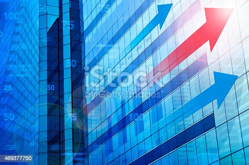 istock Red arrow with financial chart and graphs on city background 469377750