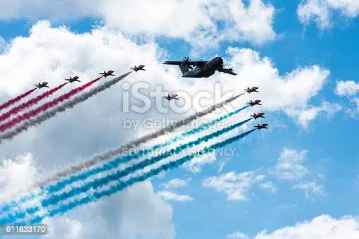 Farnborough, England - July 17, 2016: The Red Arrows and the Airbus A400M in formation for  a fly past at the 2016 Farnborough Air show.