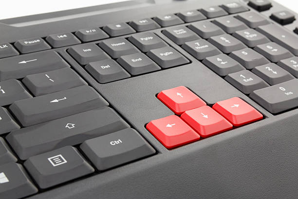 Red arrows computer keyboard stock photo