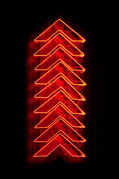 Red arrows neon light pointing up stock photo