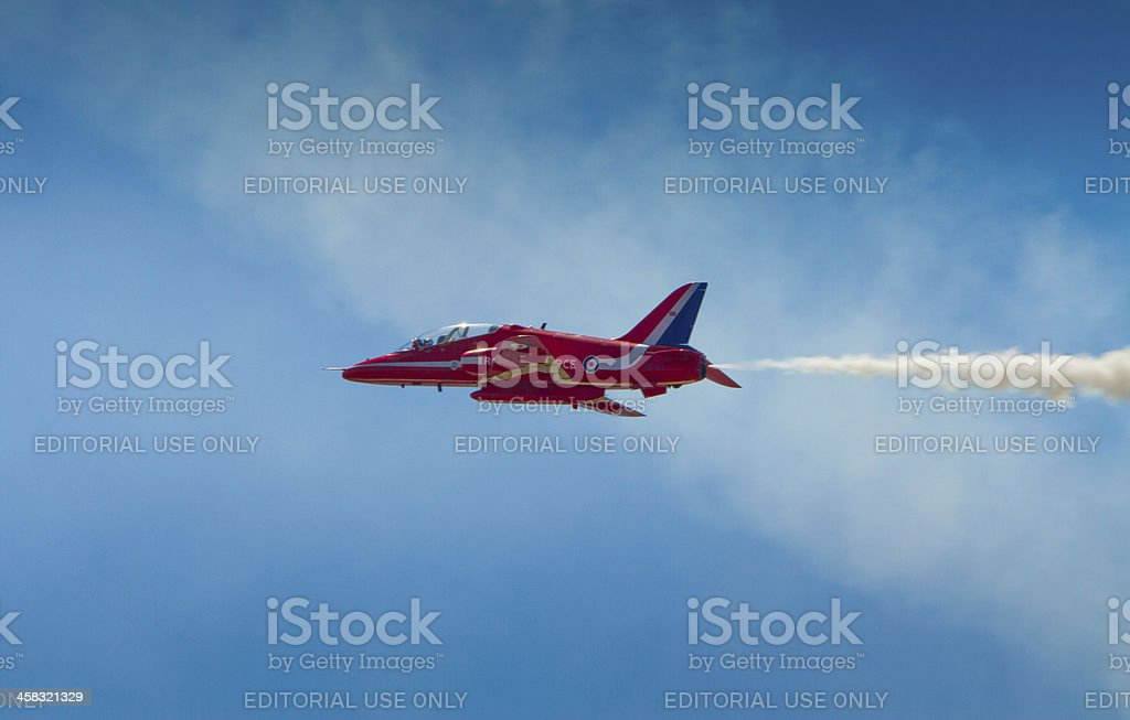 Red Arrows Plane blue sky cloud and smoke royalty-free stock photo