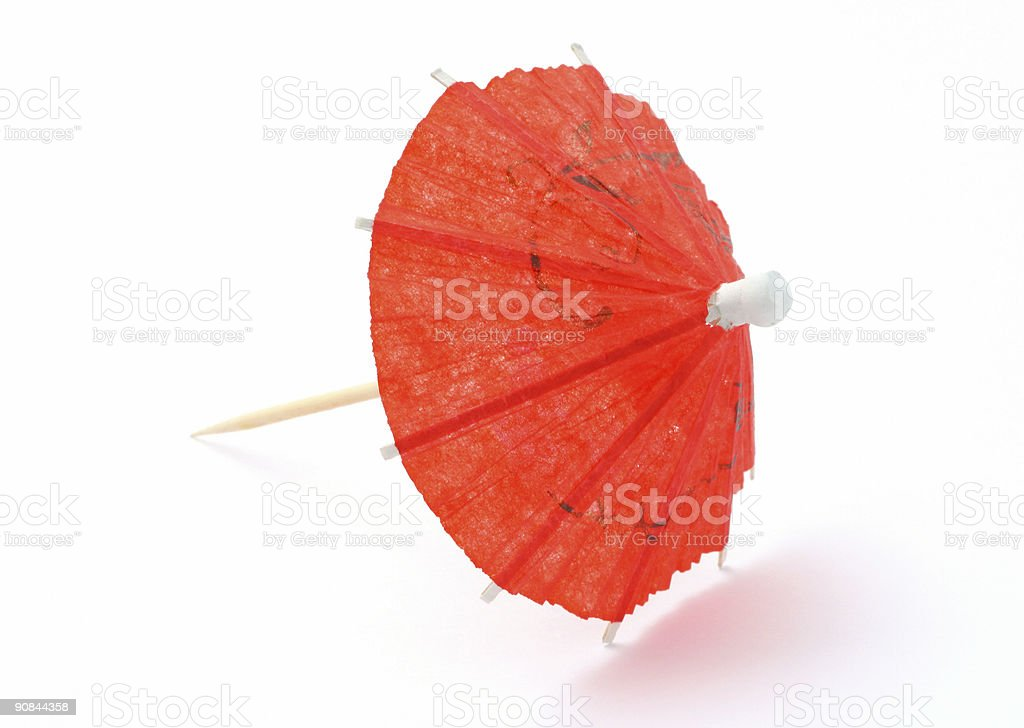 red asian cocktail umbrella on white royalty-free stock photo
