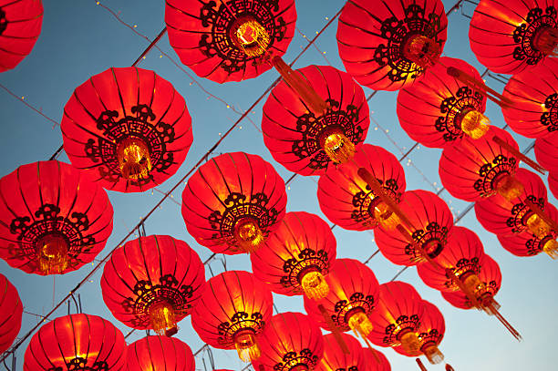 Red Asian Lanterns Asian lanterns during a religious festival.  lantern stock pictures, royalty-free photos & images