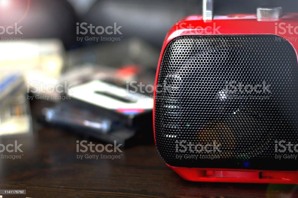 Red audio radio with black speaker closeup retro vintage 90\'s style