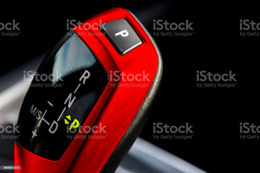 Red Automatic gear stick of a modern car, car interior details, close up view stock photo