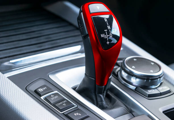 Red Automatic gear stick of a modern car, car interior details, close up stock photo