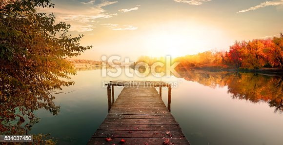 istock Red autumn and fishing pier 534037450
