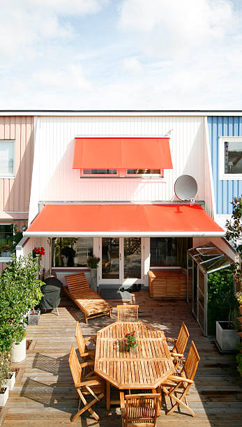 red awnings and terrace stock photo