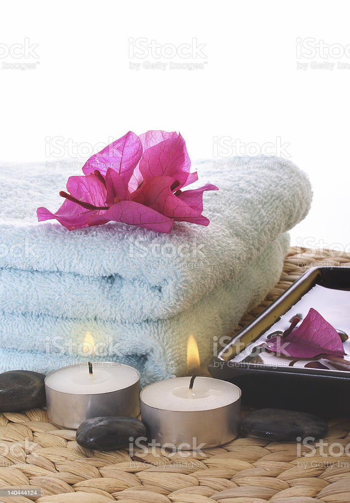 Red azalea,candle and blue towel on mat royalty-free stock photo