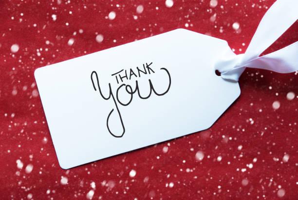Roter Hintergrund, Label mit Text Danke, Schneeflocken – Foto