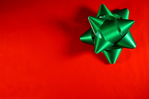 A red background with a green star ribbon on the top right stock photo