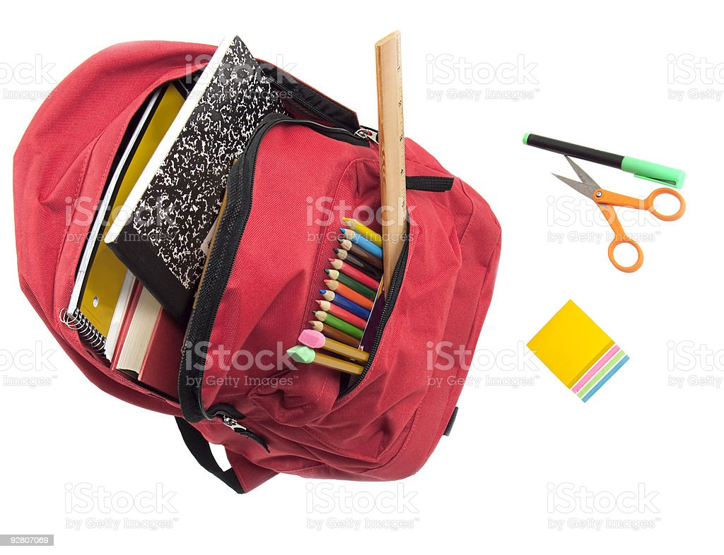 Red backpack stuffed with school supplies royalty-free stock photo