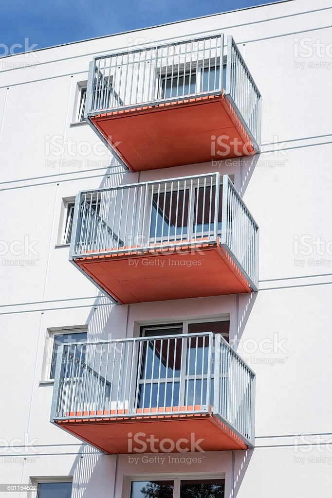 Red Balconies In White Apartment Building Stock Photo | IStock