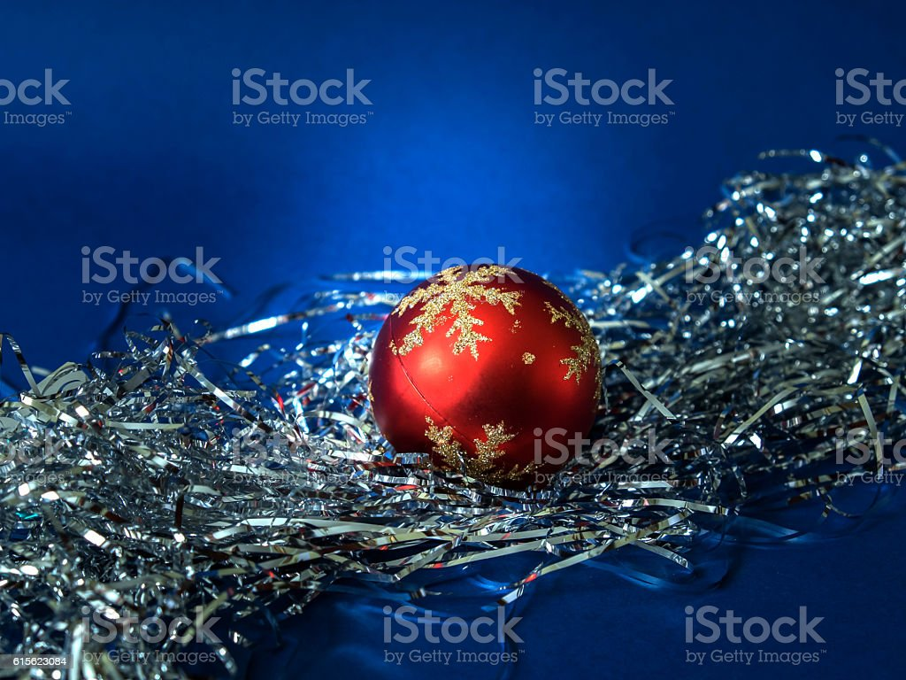 Red ball in silver trumpery stock photo