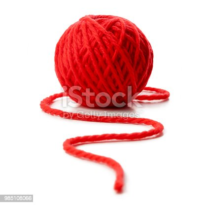 Red ball of wool on white background.