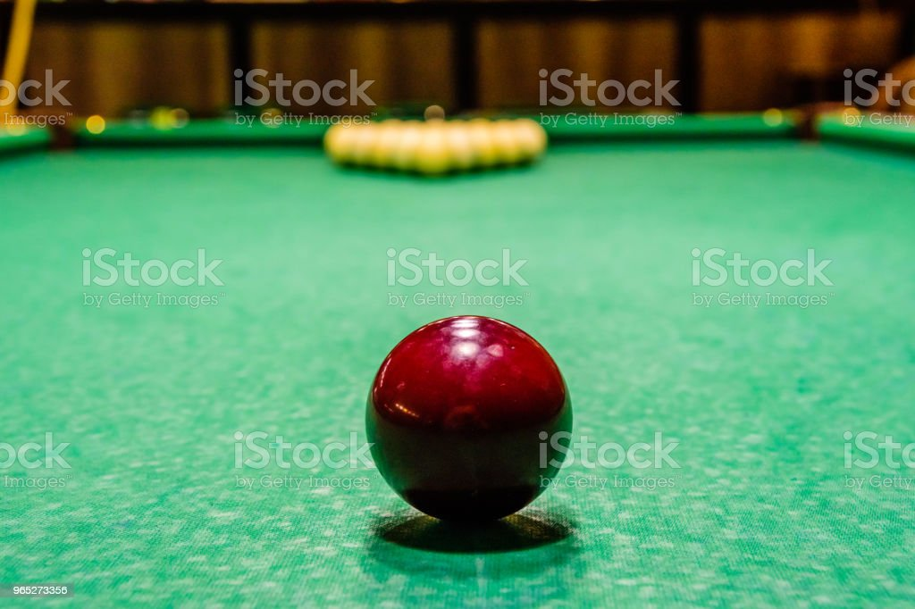 Red ball on the green cloth. Russian billiard royalty-free stock photo