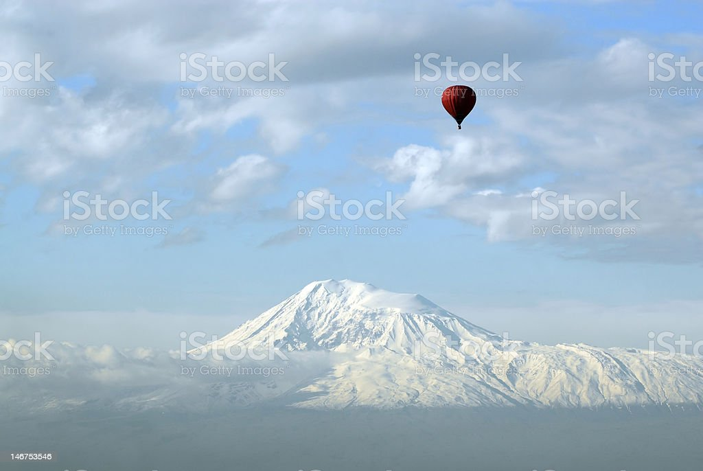 Red balloon in clouds royalty-free stock photo