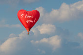 Red balloon in heart shape and a love confession