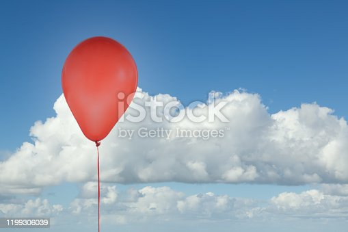 1141701990 istock photo Red balloon isolated at blue sky with clouds 1199306039