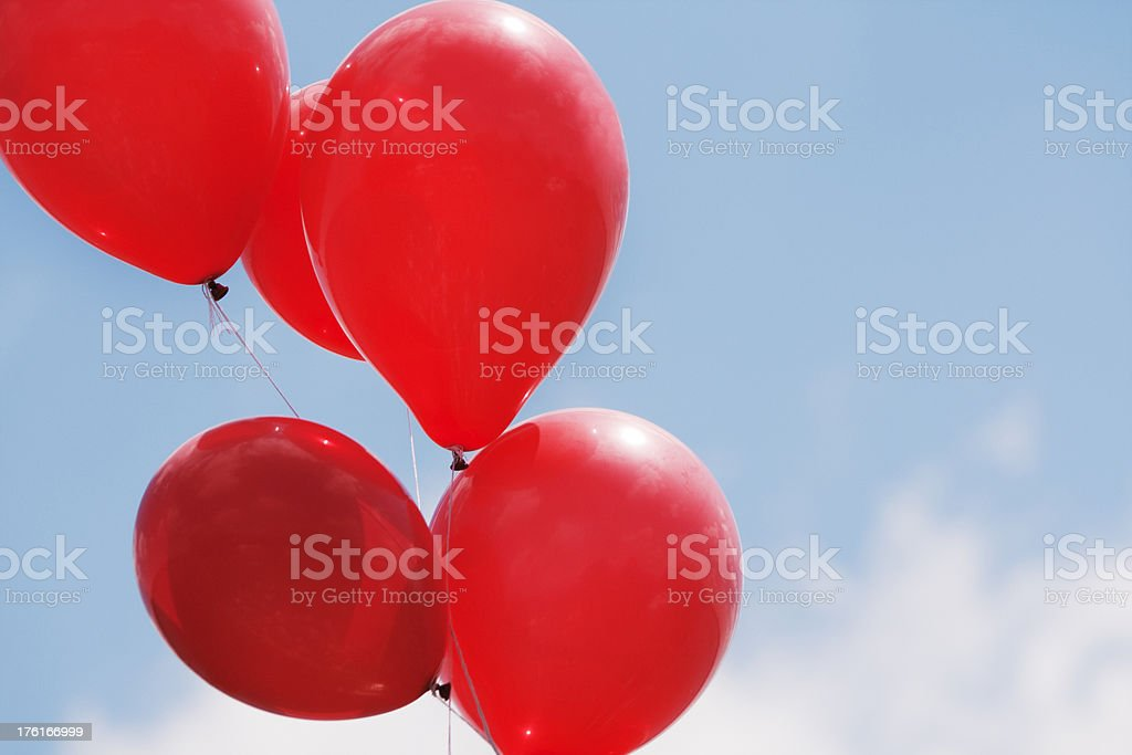 Red Balloons Against Blue Sky royalty-free stock photo