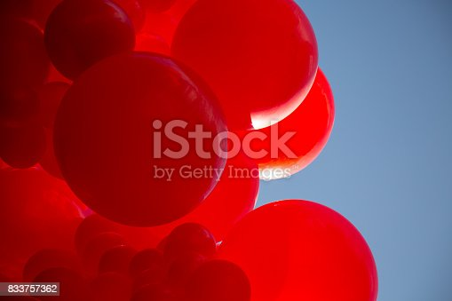 istock Red balloons blue sky background fun decoration 833757362