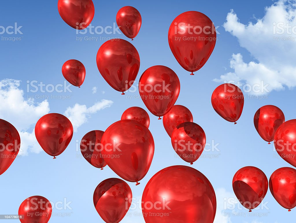 red balloons on a blue sky stock photo
