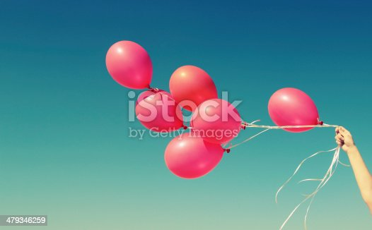 istock red balloons on the background of blue sky 479346259