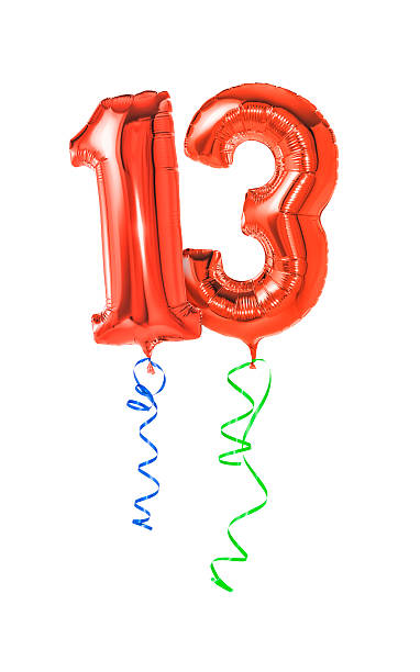 Red balloons with ribbon - Number 13 stock photo