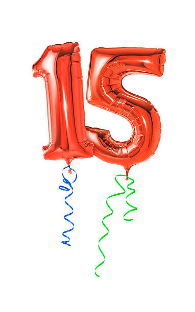 Red balloons with ribbon - Number 15 stock photo