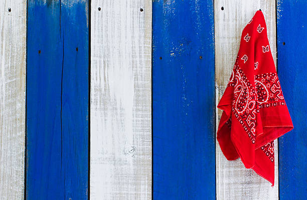 Red bandanna hanging on wood background stock photo