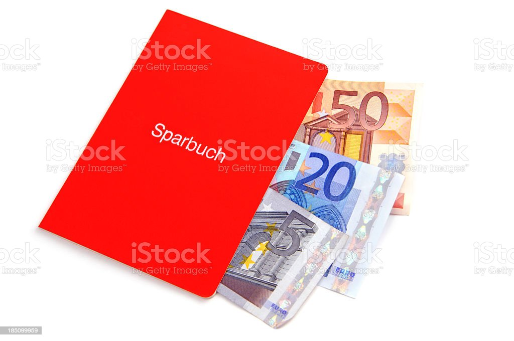 Red bank book with three denominations of bills coming out stock photo