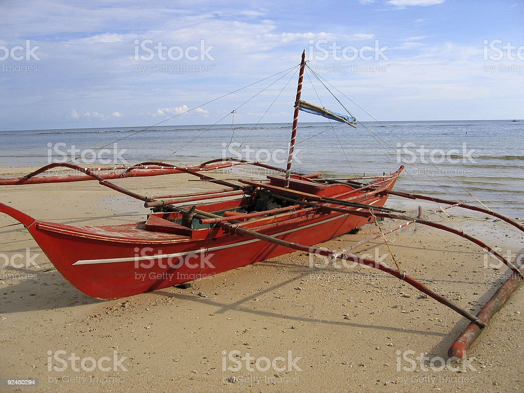 red banka outrigger on beach philippines royalty-free stock photo