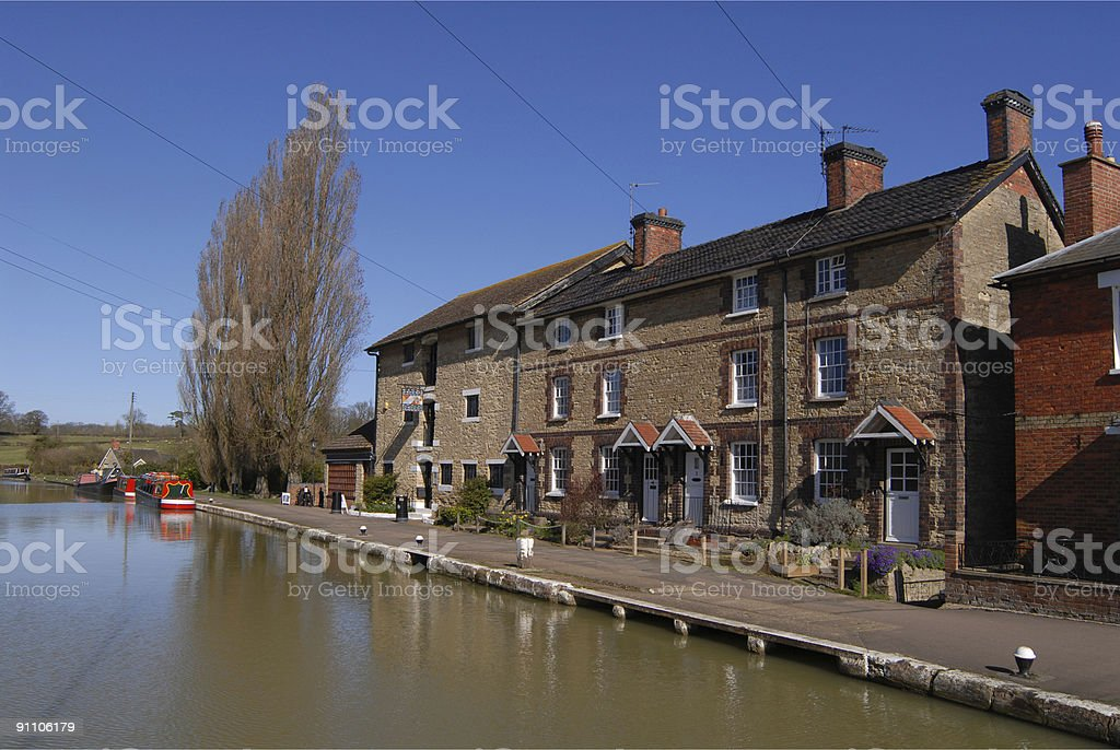Red barge moored on a canal side. stock photo