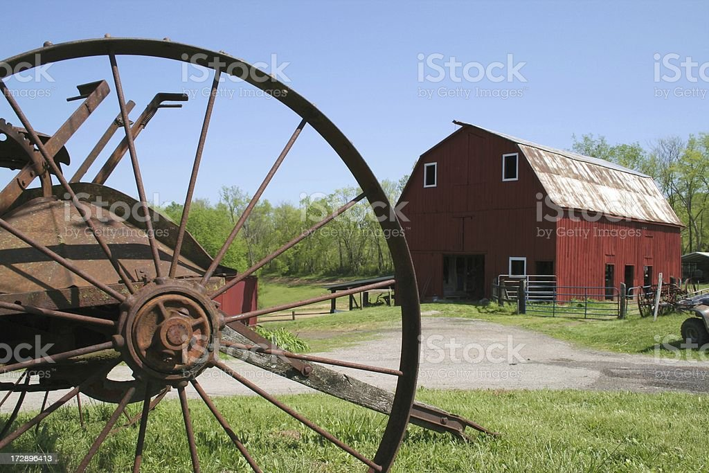 Red Barn and Old Farm Equipment royalty-free stock photo