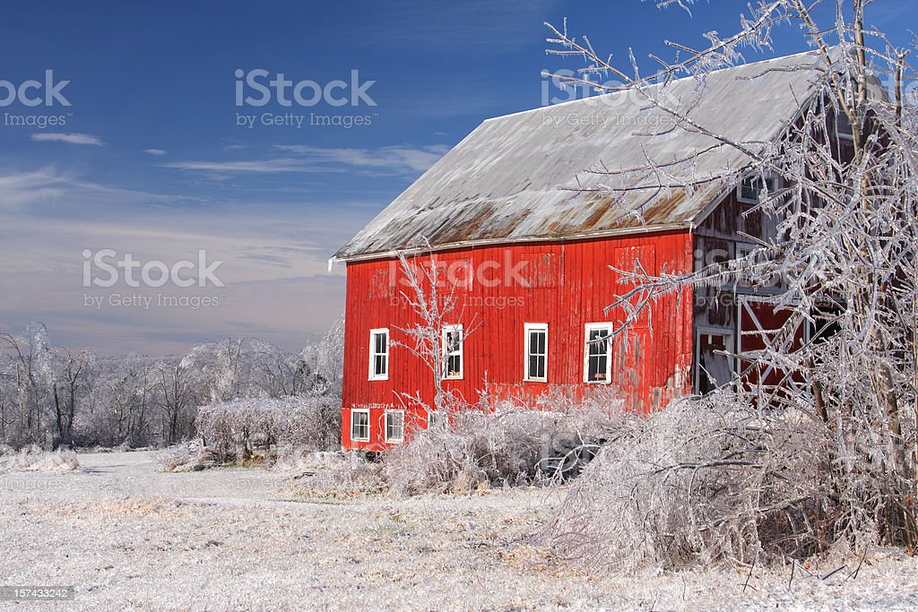 Red Barn covered in thick glaze of Ice stock photo